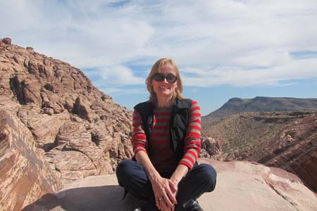 Paula-sitting-on-balancing-rock-red-rock-canyon